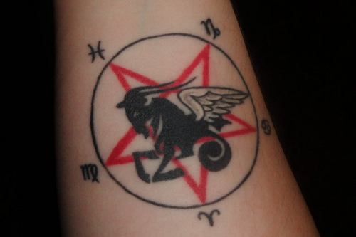 Red Star and Winged Capricorn Tattoo