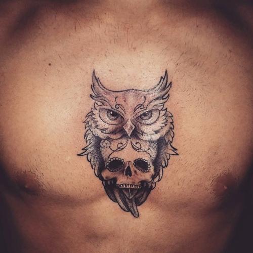 Skull In Owl Tattoo On Chest