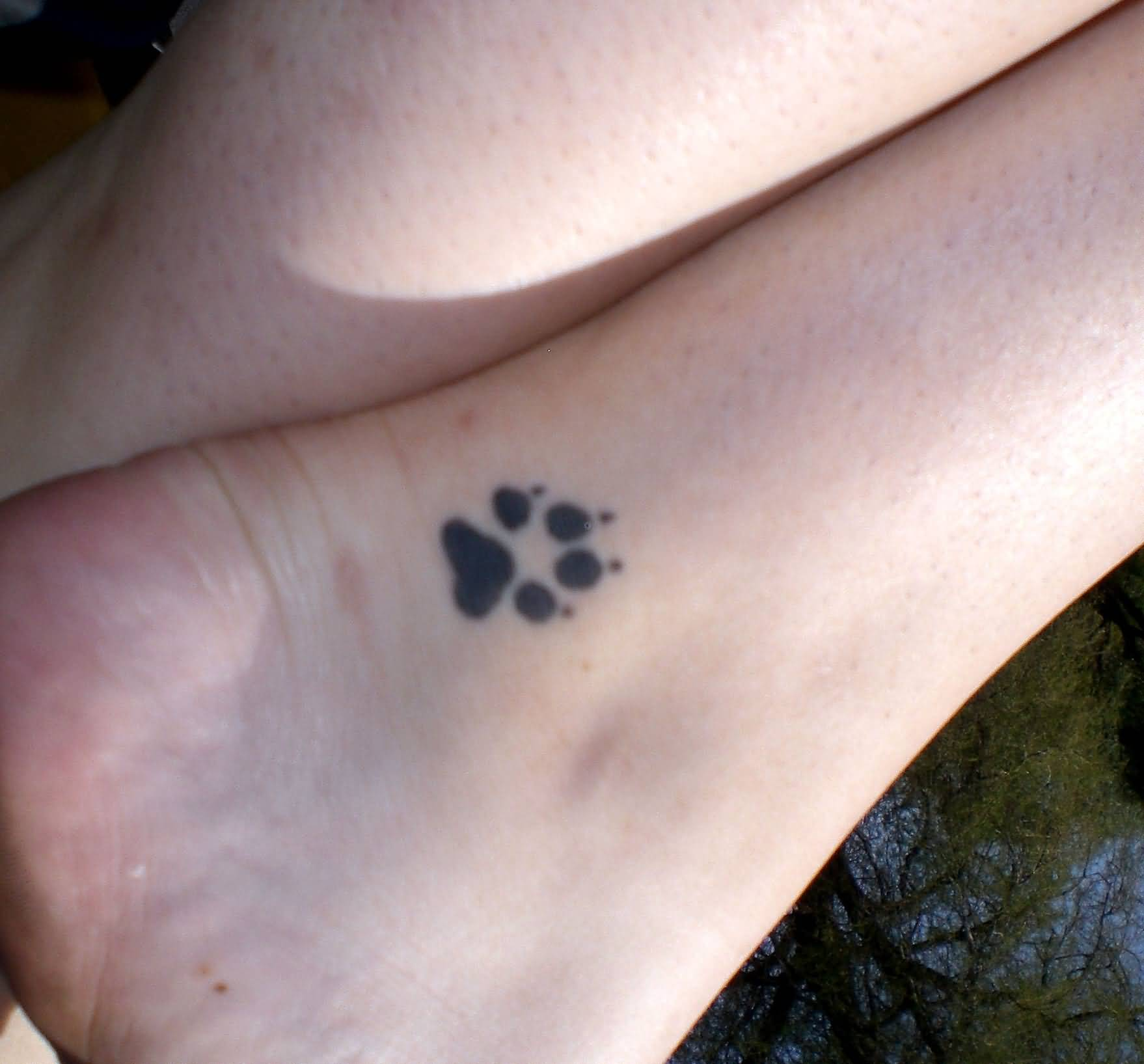 Small Paw Print Tattoo On Ankle
