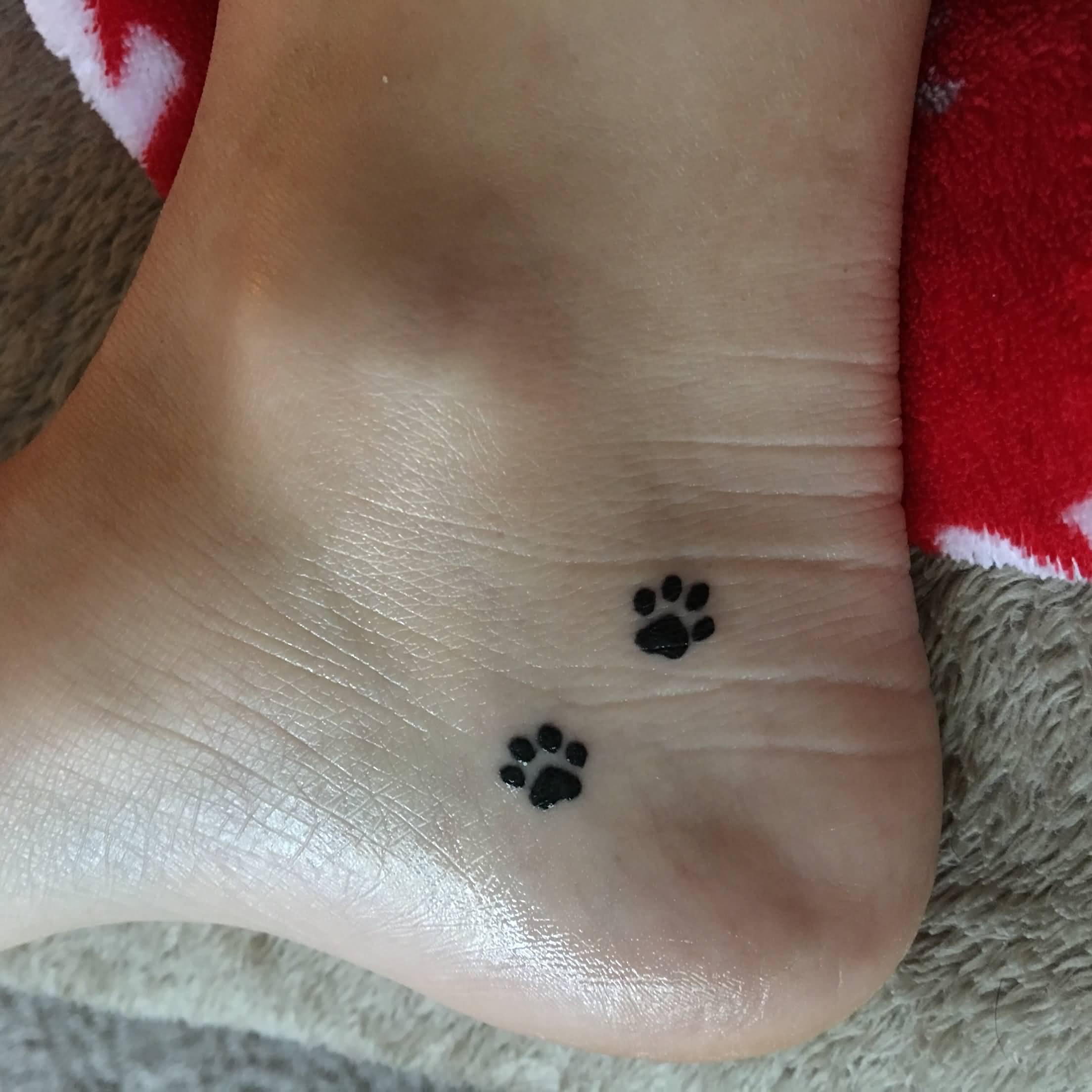 Paw Prints Tattoos On Neck