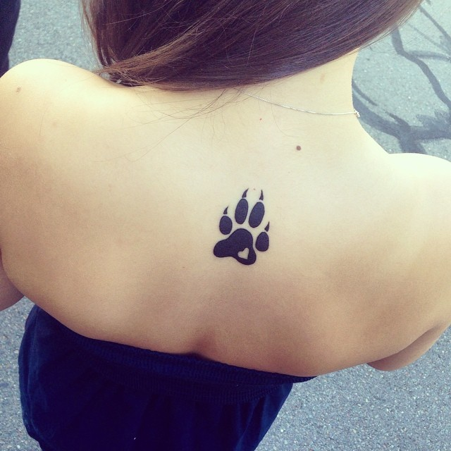 Tiny Heart In Black Paw Tattoo On Upper Back
