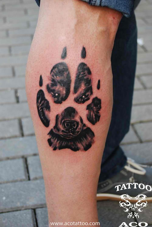 Wolf Face In Paw Tattoo On Side Leg