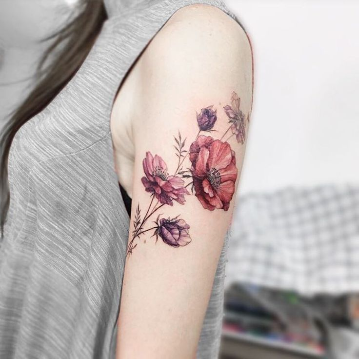 girl half sleeve flower tattoo