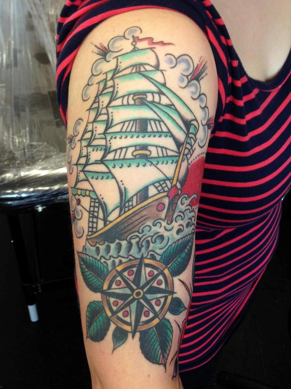Girl With Ship Tattoo On Right Half Sleeve