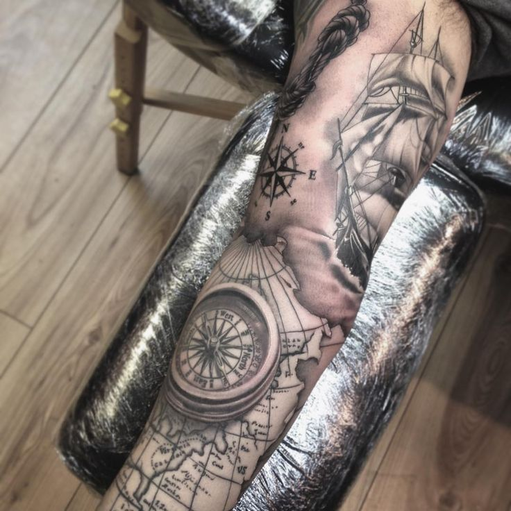 Grey Ink Compass And Ship Tattoo On Full Sleeve