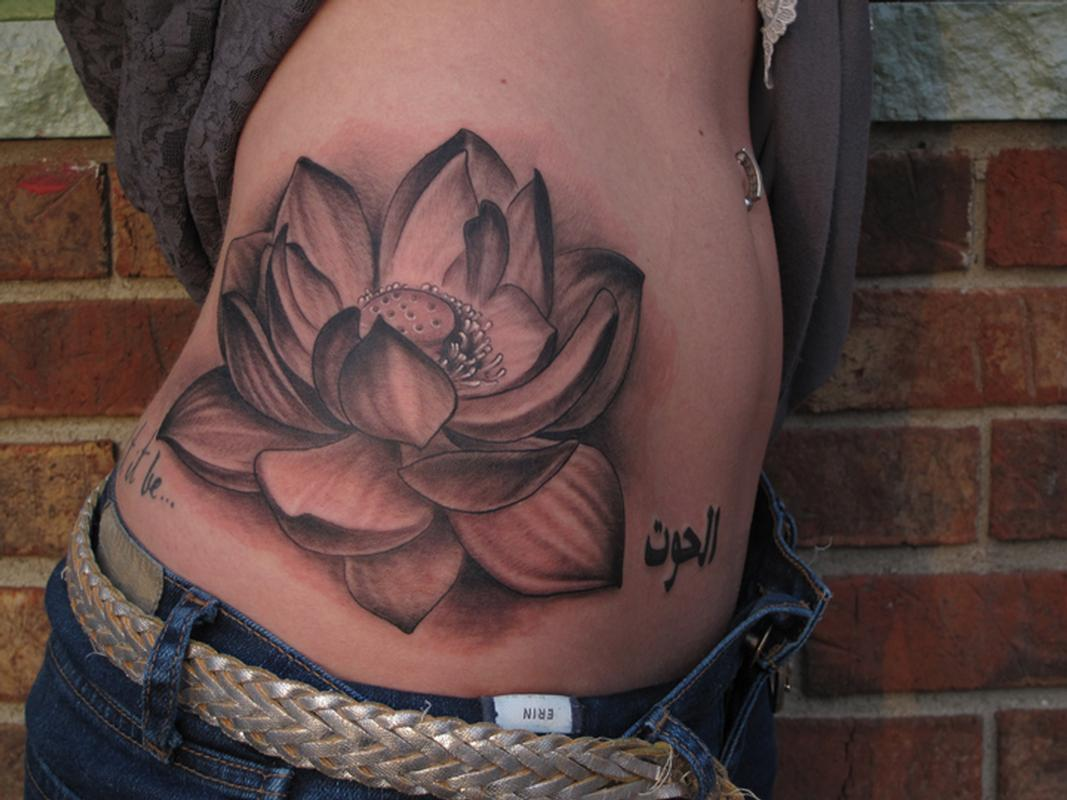 Grey ink lotus flower tattoo on side rib izmirmasajfo