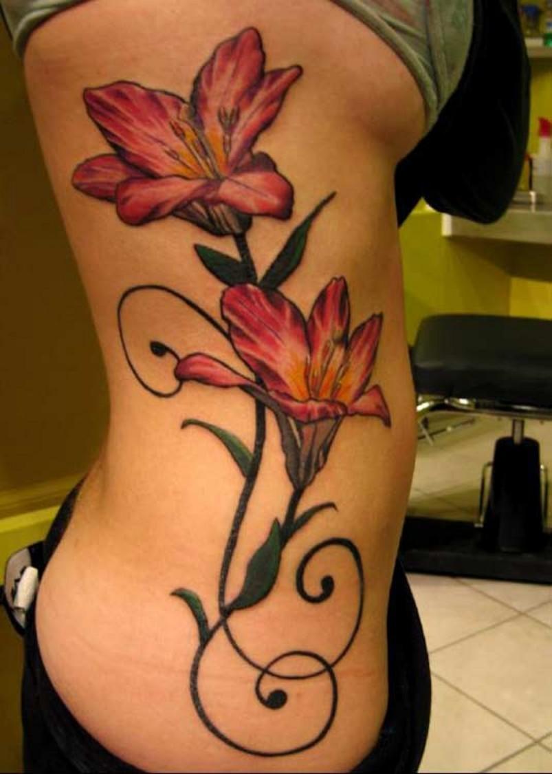 Blue flower tattoo idea nice side rib lily flower tattoo idea izmirmasajfo