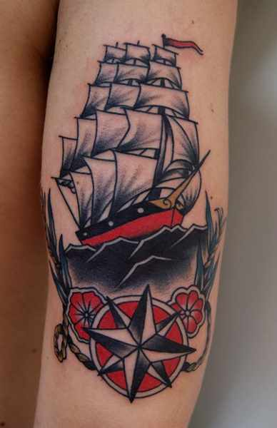 Traditional Star And Ship Tattoo On Arm Sleeve