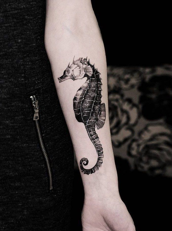 Black And Grey Seahorse Tattoo On Forearm