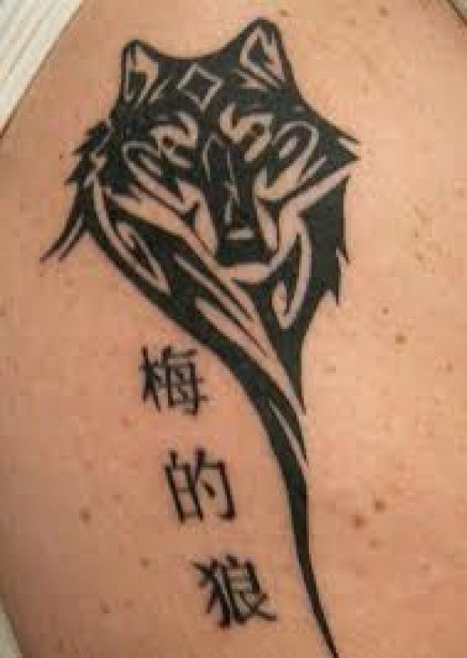 Chinese Symbols And Tribal Wolf Head Tattoo