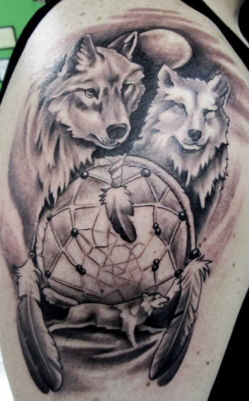 Grey Ink Dreamcatcher And Wolf Head Tattoos On Shoulder Fascinating Wolf Head Dream Catcher