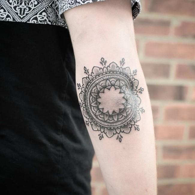 Grey Mandala Flower Tattoo On Elbow