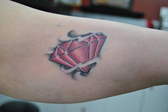Nice Red Diamond Tattoo On Inner Bicep