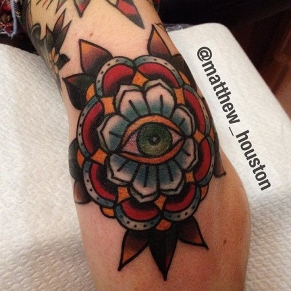 Traditional Eye In Flower Tattoo On Elbow