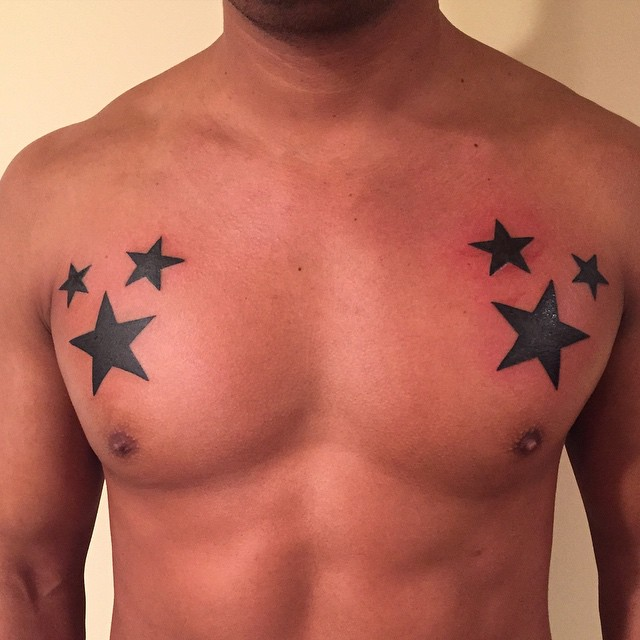 Black Star Tattoos On Man Chest