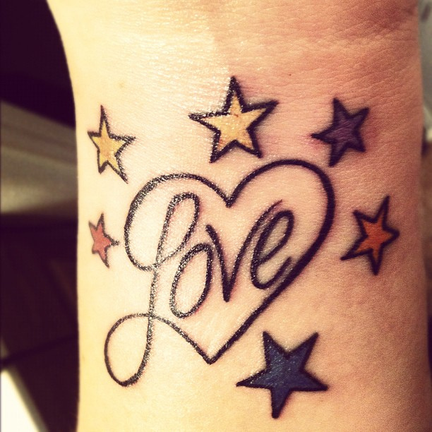 Colored Stars And Love Heart Tattoo On Wrist
