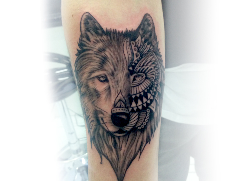 Grey And Black Ink Wolf Head Tattoo On Forearm