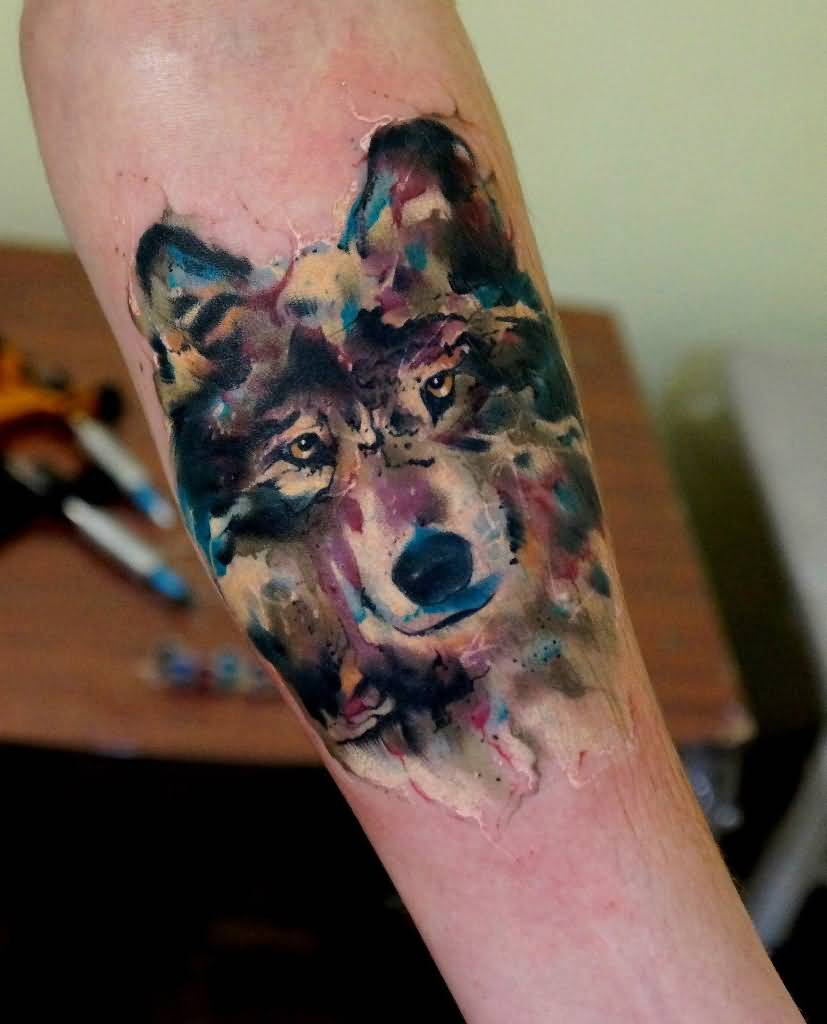 Watercolor Howling Wolf Tattoo On Left Forearm
