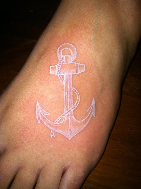 White Ink Anchor Tattoo On Left Foot