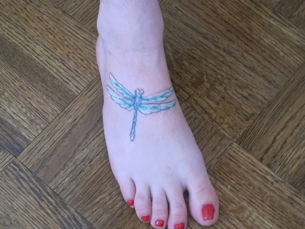 Dragonfly tattoo design on foot