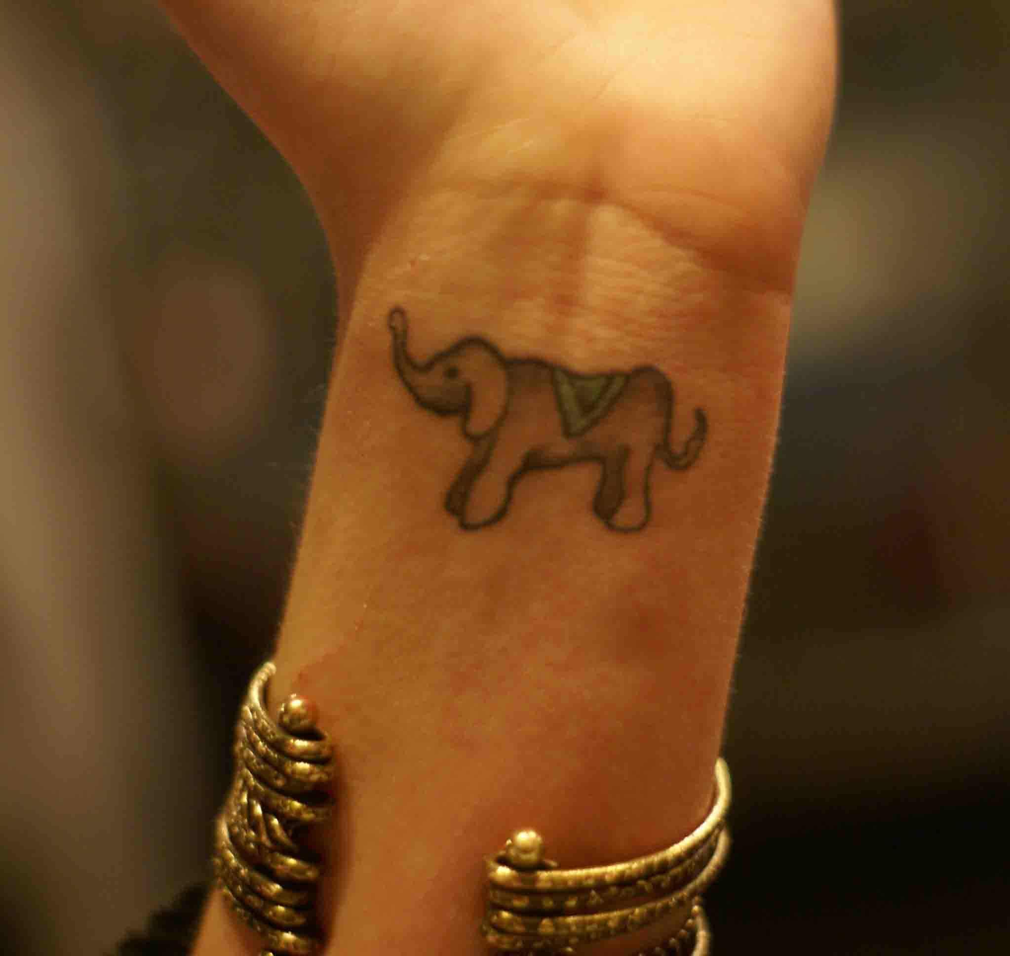 tiny elephant on wrist