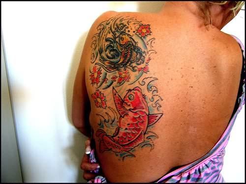 Girl Left Side Rib Fish Tattoo For Girls