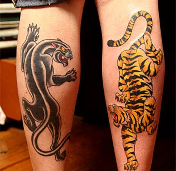 Leopard And Panther Tattoos On Leg