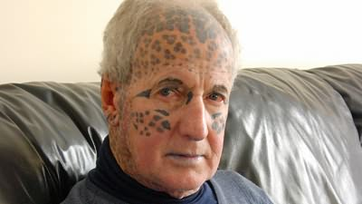 Leopard Print Tattoos On Face And Head