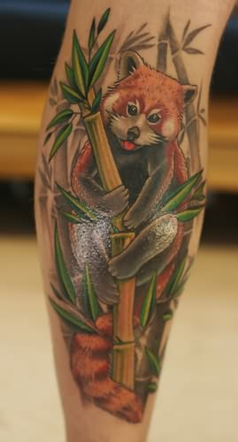 Panda Climbing On Tree Tattoo