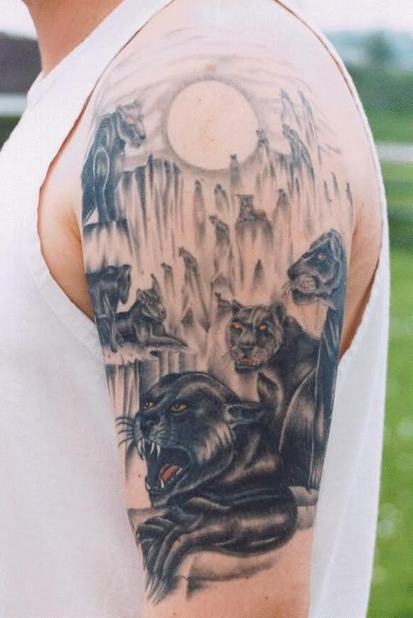 panthers and moon tattoo on shoulder
