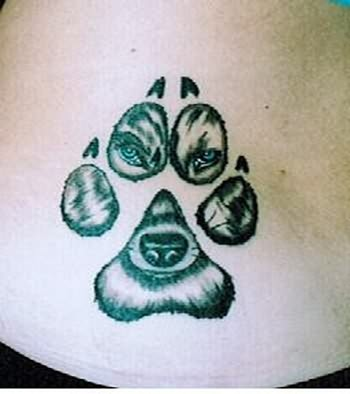 Wolf Face In Paw Print Tattoo