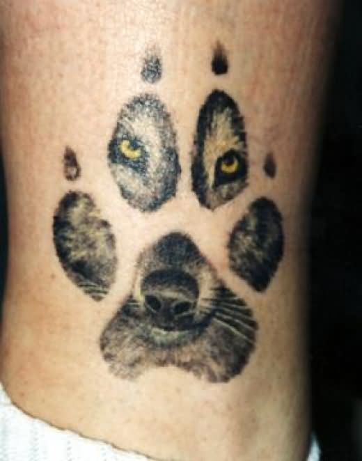 Cool Wolf Looking Throgh Paw Tattoo