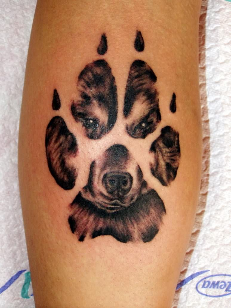 Paw And Wolf Image In Paw Tattoo