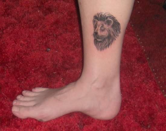 Lion Face Tattoo On Leg