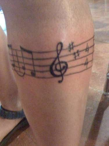 Muscial band tattoo on leg for Thigh band tattoos for females