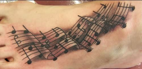 Music Symbol Tattoo On Foot