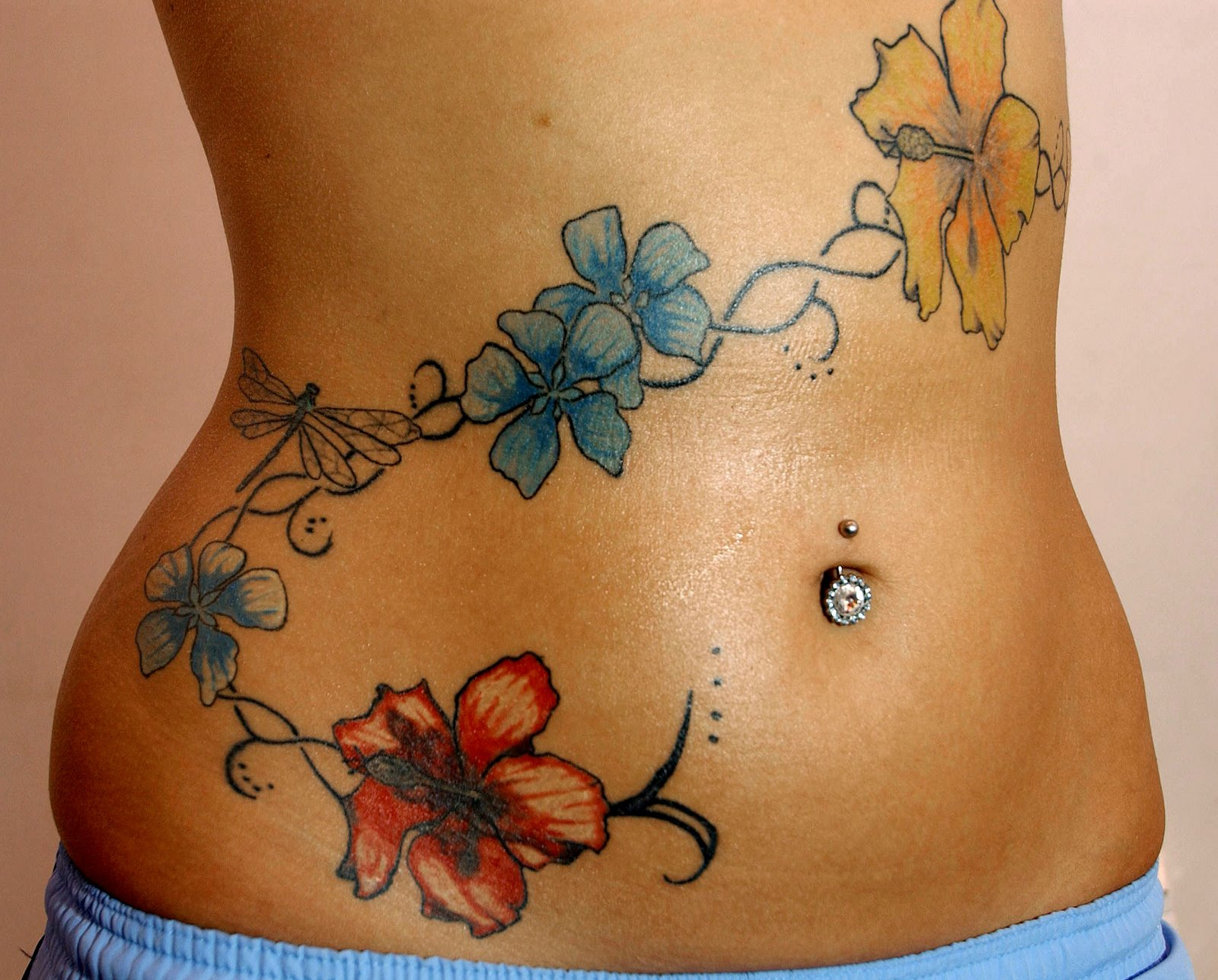 Belly tattoo images designs for Belly tattoos for female