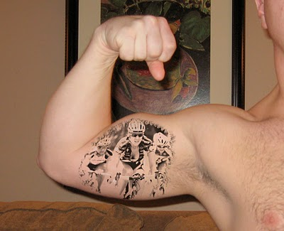 Byk Racer Tattoo On Biceps