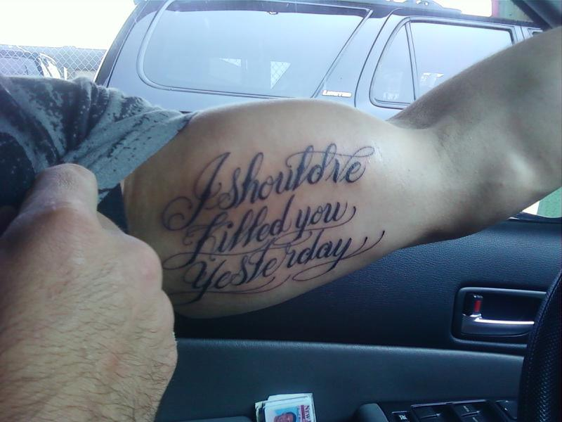 Wording Tattoo On Biceps