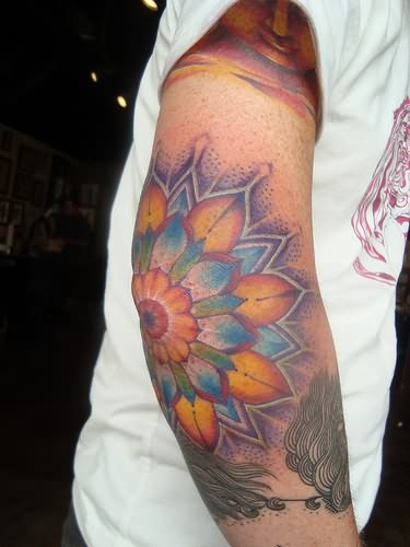 Extreme flower tattoo on elbow for Tattoo on elbow