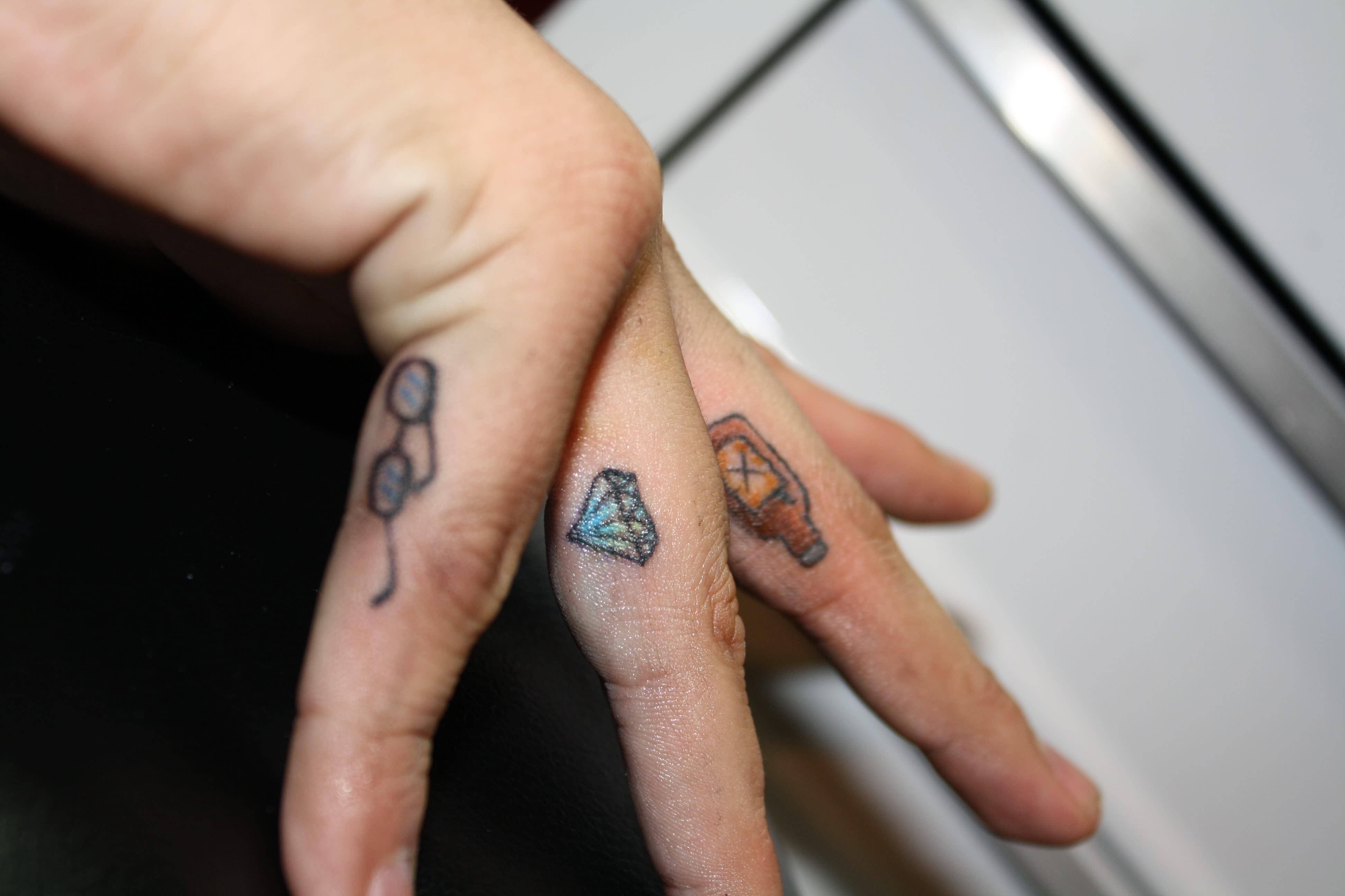 Tattoos On Fingers