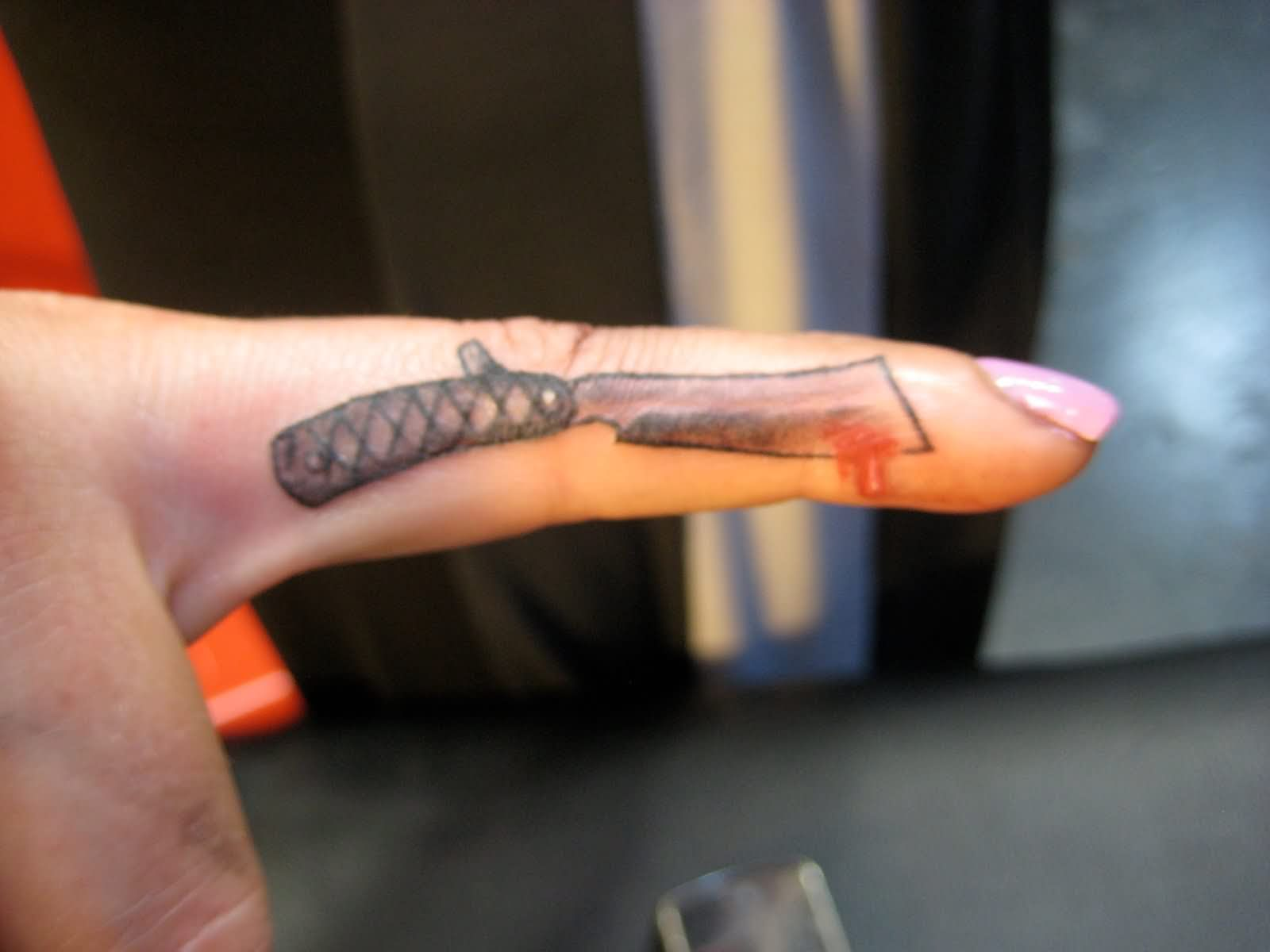 Knife tattoo on finger for Finger tattoo ideas