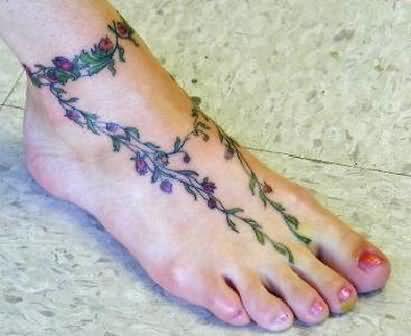 flowers vine design tattoo on foot. Black Bedroom Furniture Sets. Home Design Ideas