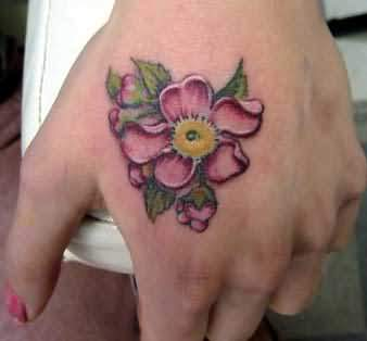 Flower tattoo on hand for Flower tattoos on hand