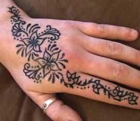 Flower tattoos on hands for girls
