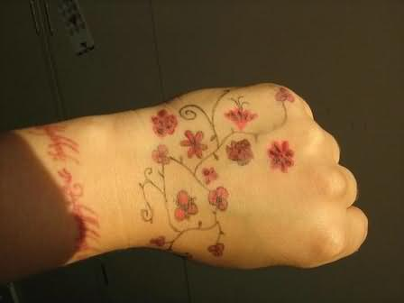 Red flowers tattoos on hand for Flower tattoos on hand