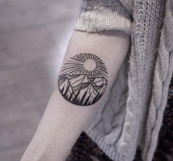 awesome mountain and sun tattoo on forearm. Black Bedroom Furniture Sets. Home Design Ideas