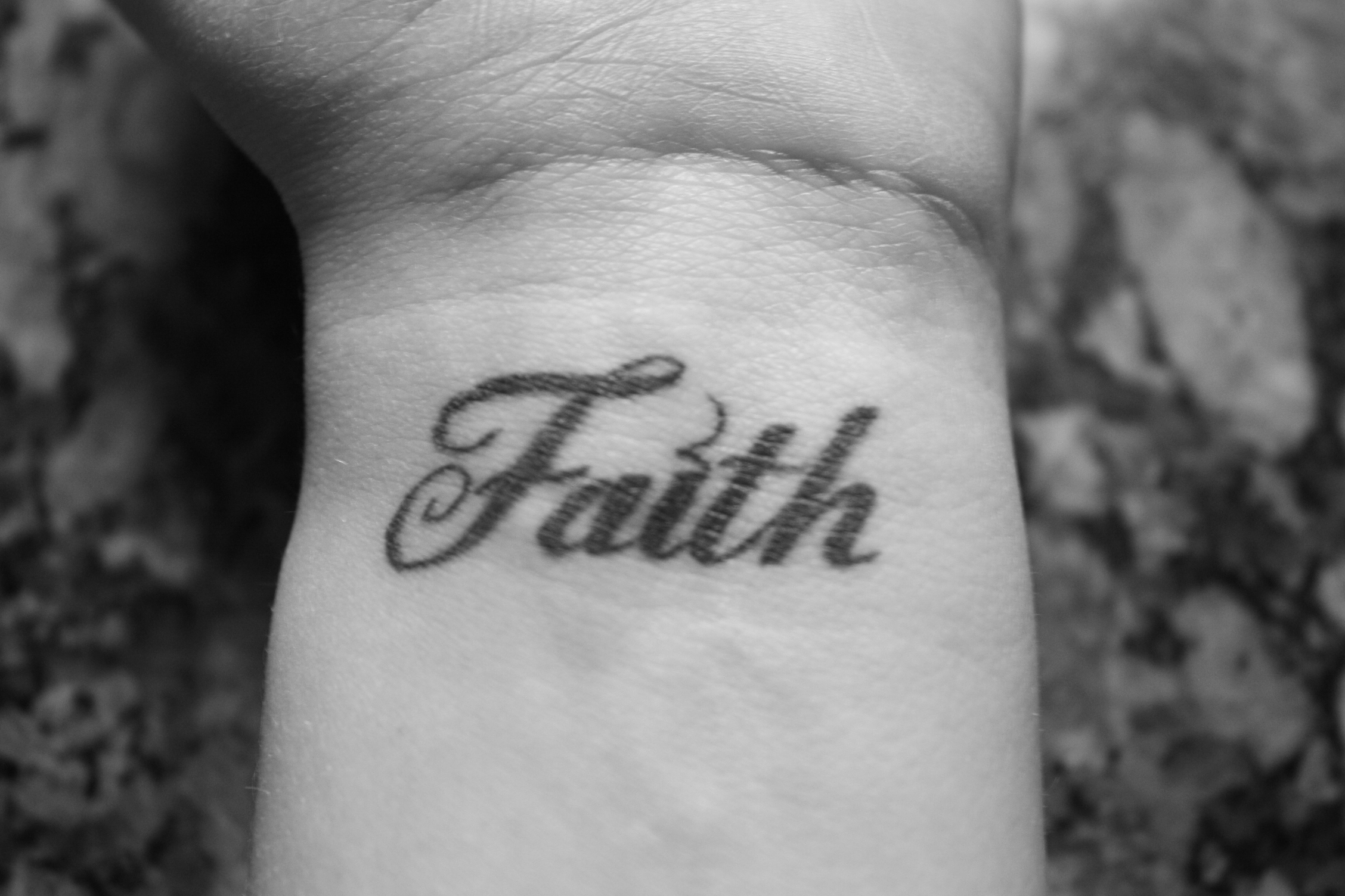 Amazing Faith Text Tattoo On Wrist