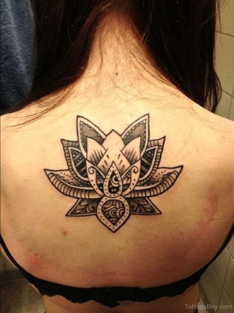 Black and white tribal lotus tattoo on back izmirmasajfo Images