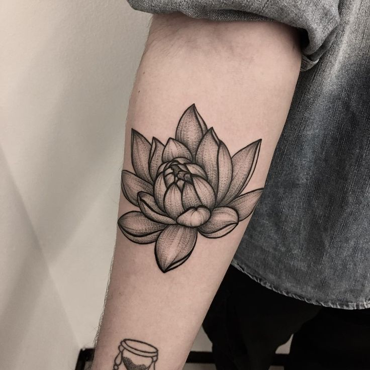 Black ink lotus flower tattoo on forearm for Forearm flower tattoos